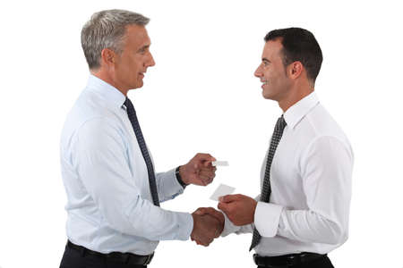 duo: duo of businessmen exchanging visit cards