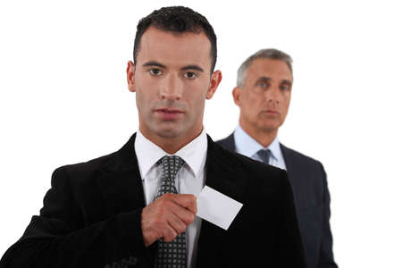 Businessman receiving card photo