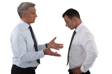 reprimand: Boss and employee having a serious discussion