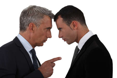 Younger and older businessmen head to head photo