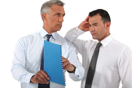 reprimanding: Businessman reprimanding his employee