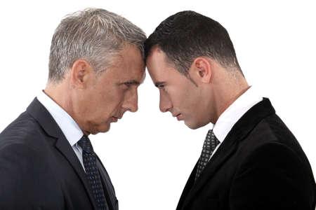 business disagreement: Tension between two businessmen