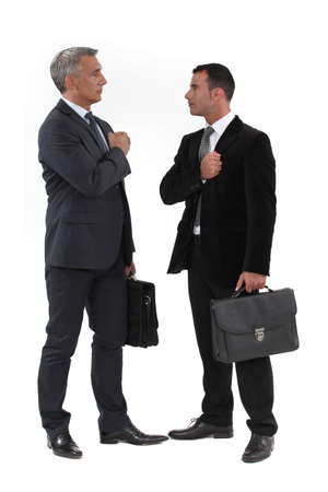morale: Businessmen trying to build up their morale before an important meeting