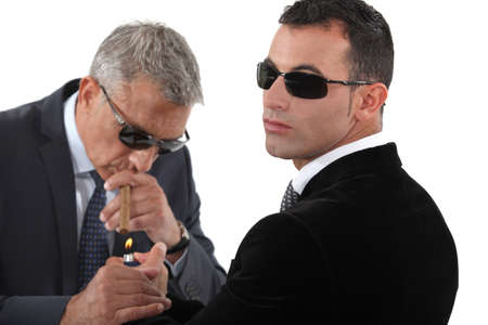 bodyguard: businessmen wearing sunglasses and smoking a cigar