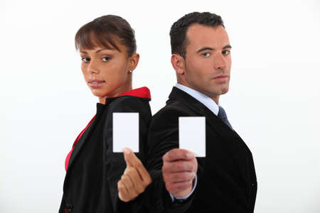 acquaintance: Businessman and woman holding calling cards Stock Photo
