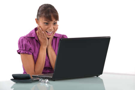 Woman delighted with her laptop Stock Photo - 19810342