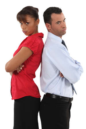 couple standing back to back after quarrel Stock Photo