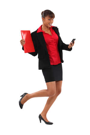 Excited businesswoman holding folder and cellphone photo