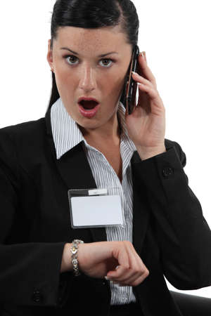 business woman phone: Shocked businesswoman talking on her cellphone