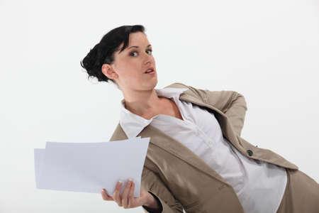 overpowering: Secretary holding paperwork