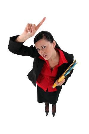 fedup: Businesswoman raising her hand