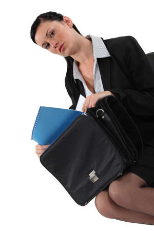 removing: Businesswoman removing paperwork from bag