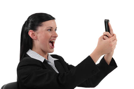 overjoyed: Overjoyed woman reading text message