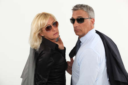 A stylish businesspeople couple. photo