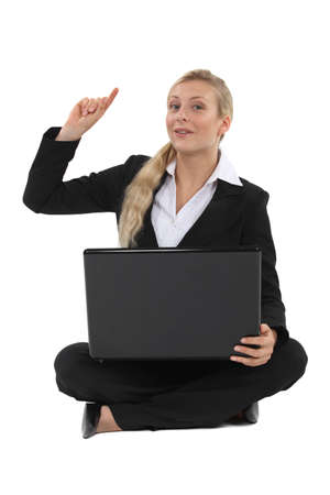 Blond businesswoman raising hand with question Stock Photo - 19783061