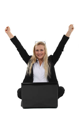 A victorious businesswoman sitting on the floor. Stock Photo - 19810114