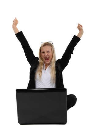 jubilation: Ecstatic woman sat with laptop Stock Photo
