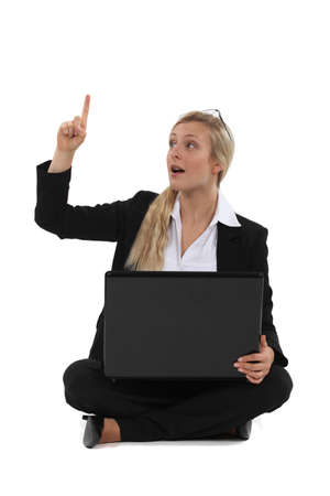Woman with laptop having idea Stock Photo - 19810060