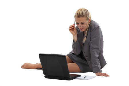 the girl in stockings: Businesswoman sitting on the floor with her laptop