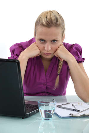 moody: Grumpy blond office worker Stock Photo