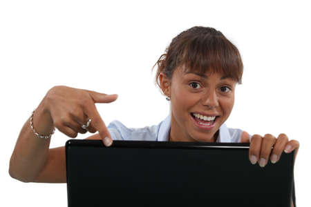 exhilarated: Woman pointing to her laptop Stock Photo