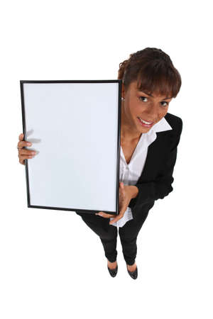 eagerness: Businesswoman holding up a whiteboard Stock Photo