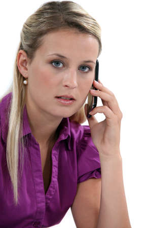 answering call: Blond woman with mobile telephone