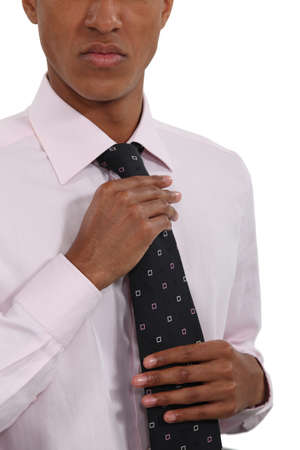 Businessman straightening his tie photo