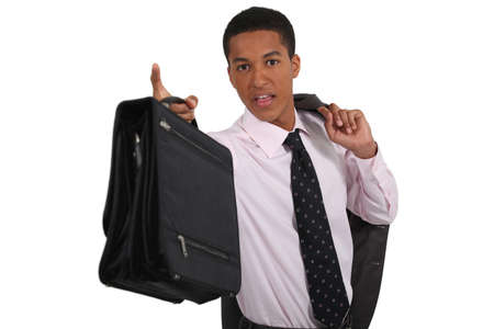 flaunt: young black manager with coat over shoulder holding briefcase