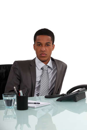 businessman waiting call: Young executive sitting by the phone