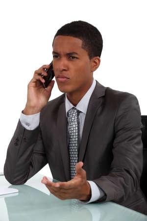Displeased businessman photo