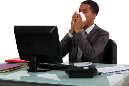 rubbing noses: Executive rubbing his nose