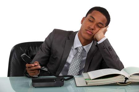 bored face: Bored businessman making phone calls Stock Photo