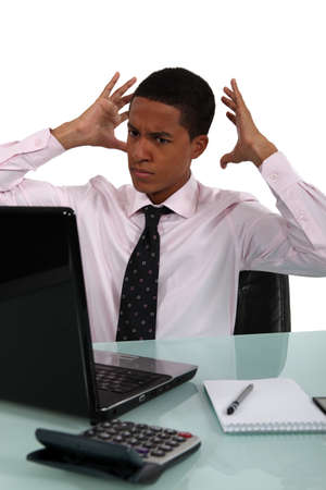 exasperated: young black businessman looking exasperated Stock Photo