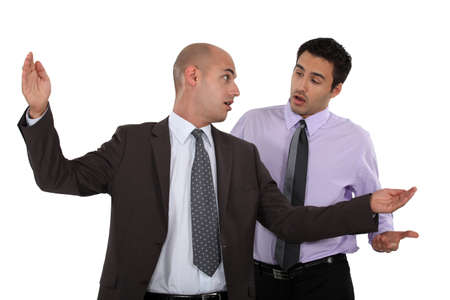 Businessmen having a disagreement photo
