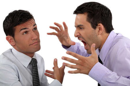 impervious: Man yelling at his apathetic colleague Stock Photo