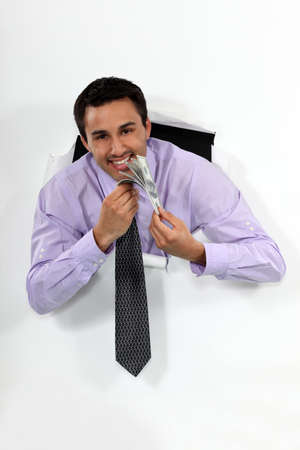 Happy businessman holding lots of money