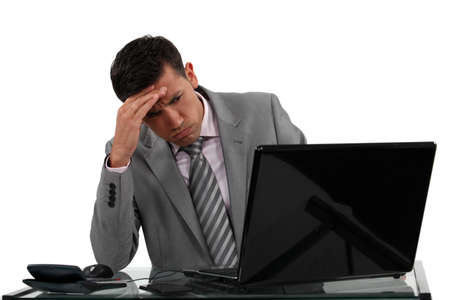 burdened: Businessman receiving a disappointing e-mail Stock Photo