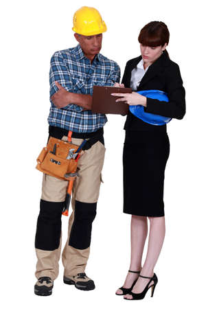concurrence: Engineer signing a form
