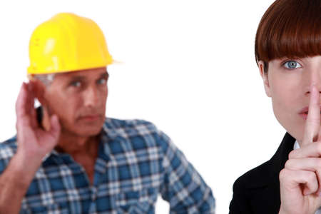Woman telling builder to be quiet photo