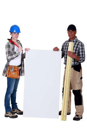 unbiased: female carpenter posing with senior instructor holding copyspace Stock Photo