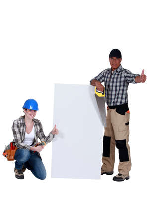 tradespeople: A team of tradespeople giving the thumbs up Stock Photo