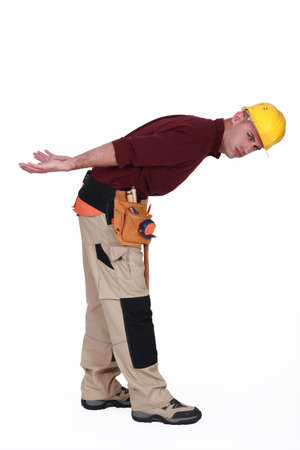 Construction worker with an imagined heavy load photo