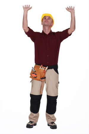 invisible object: Tradesman pushing an invisible object Stock Photo