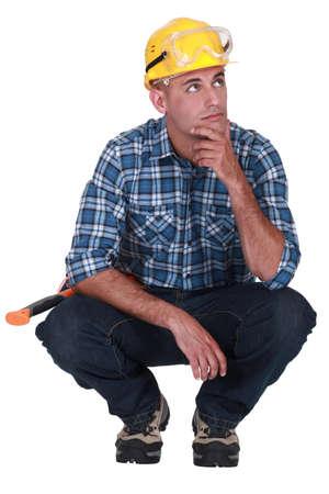 Pensive laborer Stock Photo