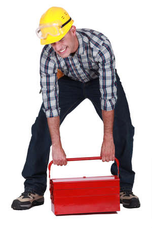 laborer: laborer lifting heavy toolbox