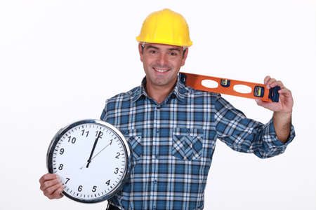 all smiles: carpenter all smiles holding ruler and clock