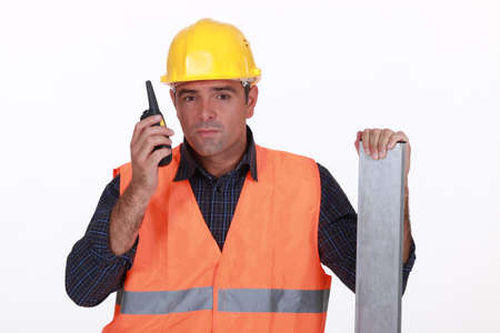 Construction worker transmitting radio photo