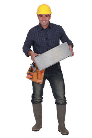 Builder carrying breeze block photo