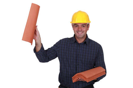 Builder holding roof tiles photo